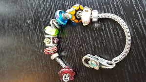 Sterling silver Trollbead bracelet with collection of beads