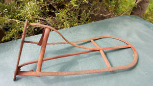 Vintage wrought iron horse saddle rack