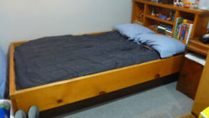 Twin size water bed with heater and shelves. pine frame