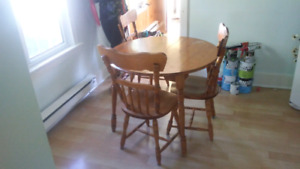 Maple table with 4 matching chairs.