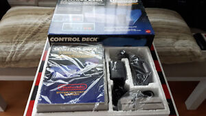 2 Nintendo systems in boxes