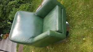 Faux leather green chair on metal swivel