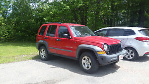 2005 Red Jeep Liberty SUV, Crossover