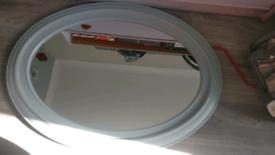 Grey oval mirror