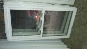 vinyl double hung slider windows (one left)