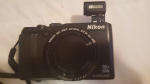 NIKON COOLPIX S9900 16.1 Digital Camera with 3.0-Inch TFT LCD