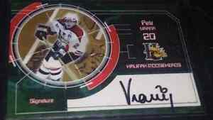 22 Serial numbered autographed Hockey Cards