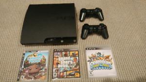 PS3 Slim + 2 manettes + 3 jeux