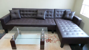 L shape sectional sofa bed black and brown color.