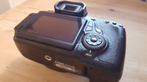 Canon 60D dslr Camera with 3 inch LCD screen + battery + strap