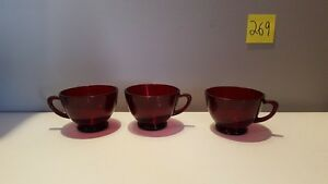 Set of three red and set of three green glass tea cups