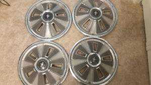 4 original 1966 Ford Mustang Hubcaps in great shape