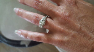People's princess cut three-stone engagement ring