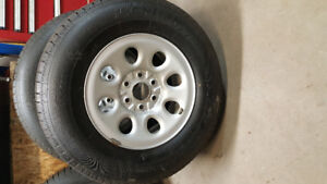 Ironman Polar Trax 265/70/17 like new rims and tires