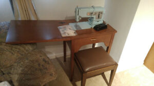 1967 Singer sewing machine in a table with stool