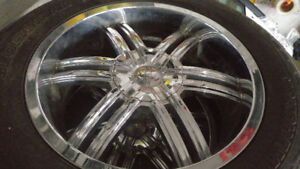 275/55/20 Yokohama tires with chrome rims.