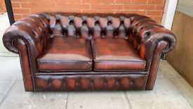 A Conker Brown Leather Chesterfield Two Seater Sofa