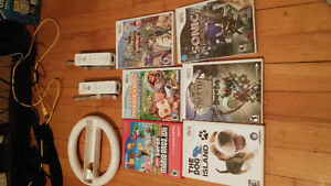 Wii Remotes,Stearing wheel and games