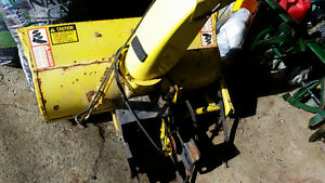 Snow blower attachment for John Deere tractor.