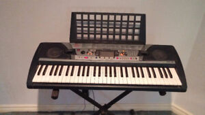 Yamaha PSR-280 Keyboard with stand. In good condition.