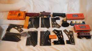 Lot of Lionel and Marx track, switches, rolling stock