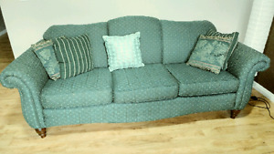 An excellent green couch!
