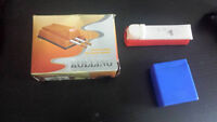 massager, black head eraser, cigarette roller & case