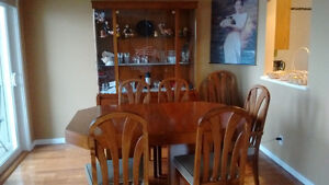 Solid oak table, chairs , and china cabinet