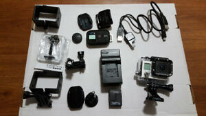 Used GoPro HERO 3 (Black Edition) and accessories for sale.