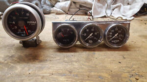 Autometer 3 3/4 tach and 3 gauges