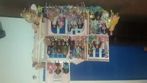 Barbie Dream House with over 50 dolls