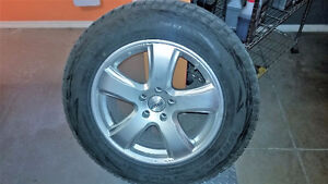 4 Blizzak snow tires with rims and sensors. 70% tread left.