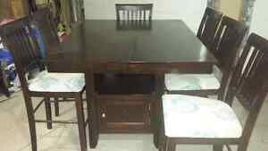 Counter height wooden table with 6 matching chairs!