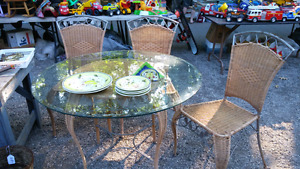 Glassed topped wicker table & 4 chairs