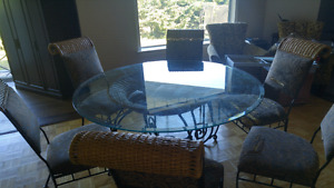 Wrought iron and wicker table and chairs