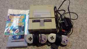 Super Nintendo system, Super Mario World and 2 controllers