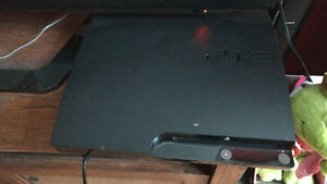 PlayStation 3 with controller and attachments and games