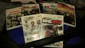 6 wii racing/sports game comes with one hockey stick