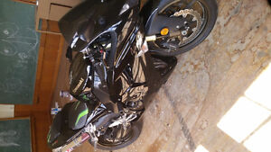 Kawasaki zx10r tuned with very low mileage.  Almost new