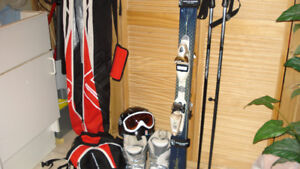 Woman's skis and accessories