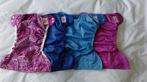 Flip adjustable cloth diapers with inserts