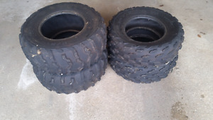 Atv tires 2 sets from a Honda and suzuki