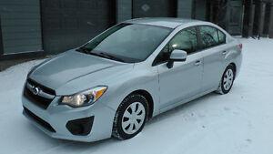 2012 Subaru Impreza 2.0i,AWD,Auto,Winter + summer tires on rims