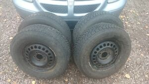 4 Goodyear Nordic winter tires and Ford rims - can deliver.