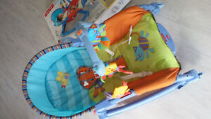 new condition fisher-price portable Rocker with box
