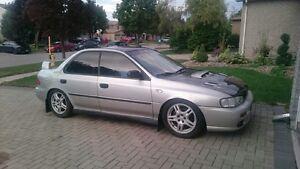 Clean 99 Subaru Impreza, lowered + mods