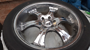 Chrome 22 inch Rims and tires for SUV.