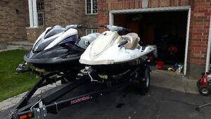 Two excellent shape jet skis and north trail double trailer