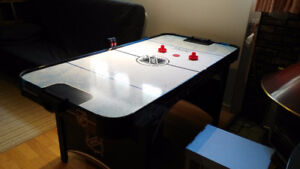 Air Hockey gaming table with electronic scoring