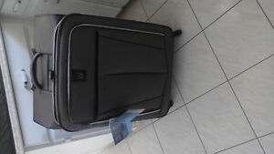 Brand new Travelpro suitcase